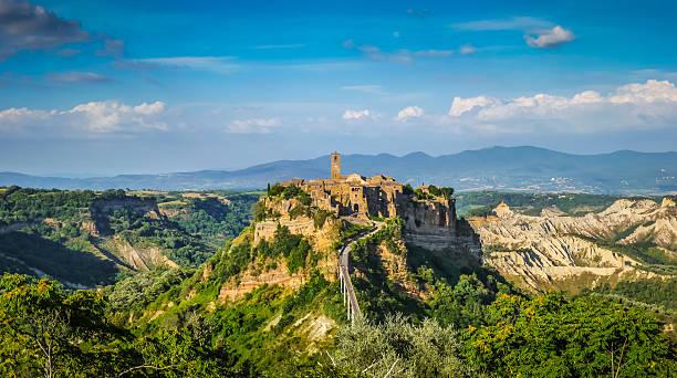Civita di Bagnoregio, Lazio, Italy Beautiful panoramic view of famous Civita di Bagnoregio with Tiber river valley in golden evening light, Lazio, Italy tuff stock pictures, royalty-free photos & images