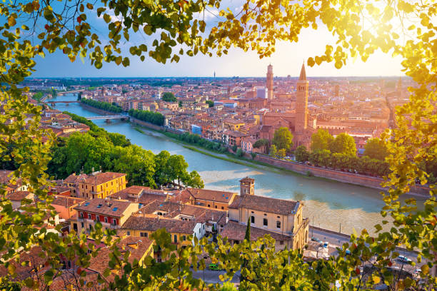 ciy of verona and adige river aerial view through leaf frame, tourist destination in veneto region of italy - unesco foto e immagini stock