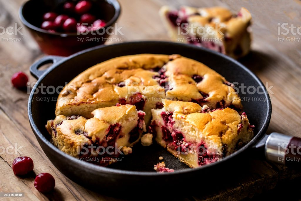 clafoutis - a traditional French cake with cherries stock photo