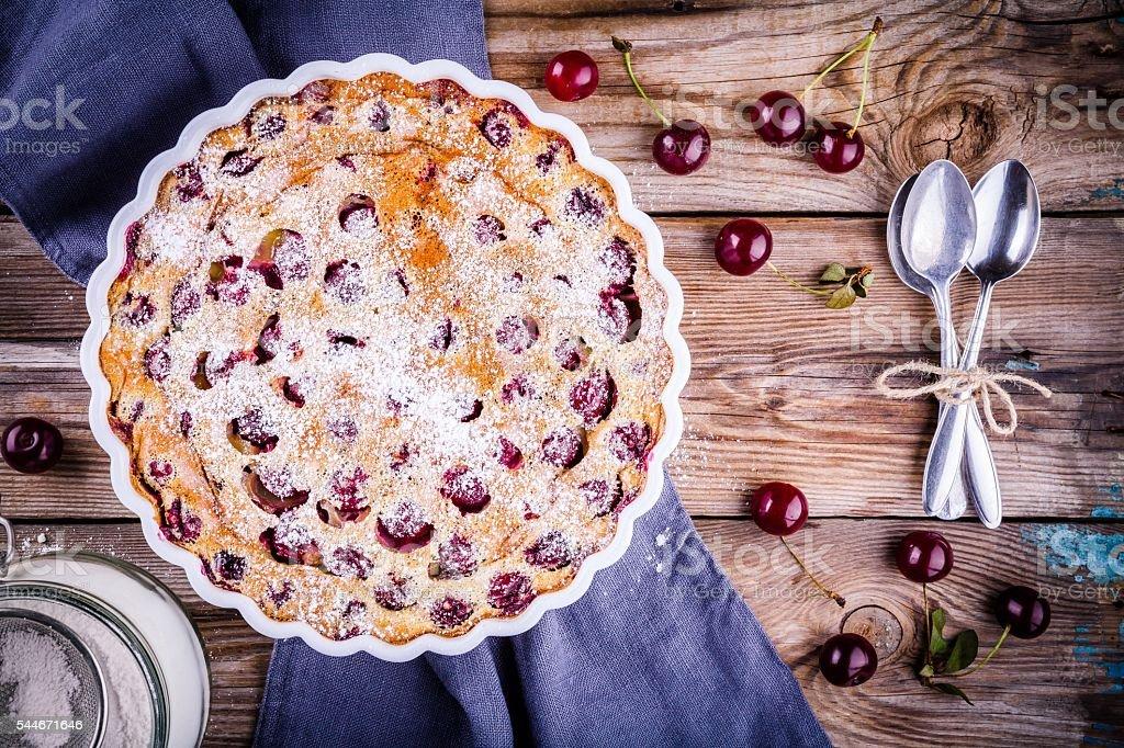 Clafoutis cherry pie on  wooden background stock photo