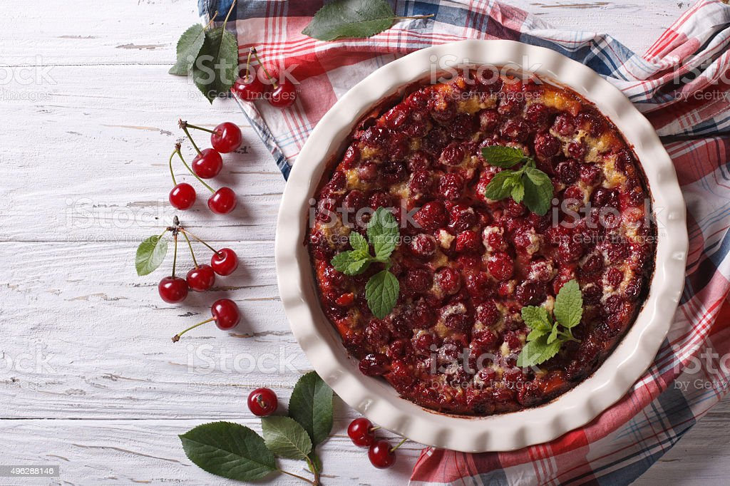 Clafoutis with cherry on the table. horizontal top view stock photo