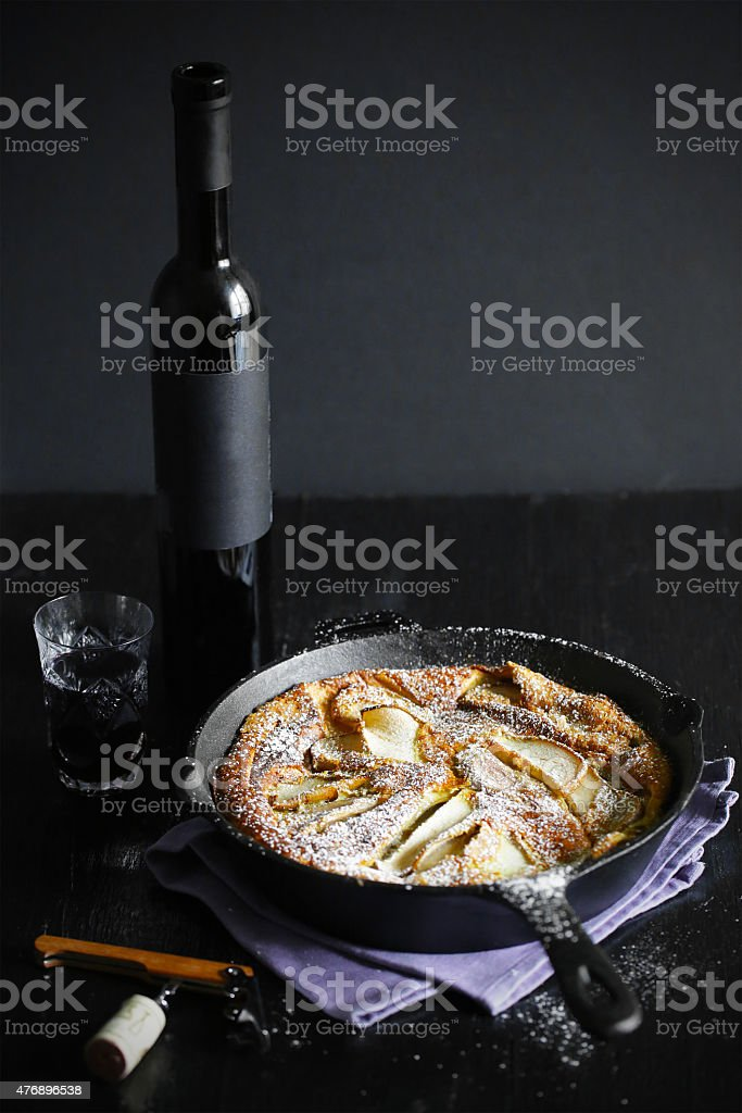 Clafoutis with pears and red dessert wine stock photo