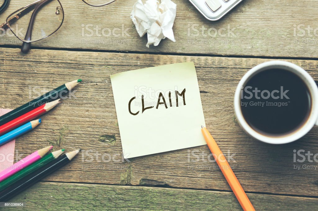 claim text on notepad stock photo