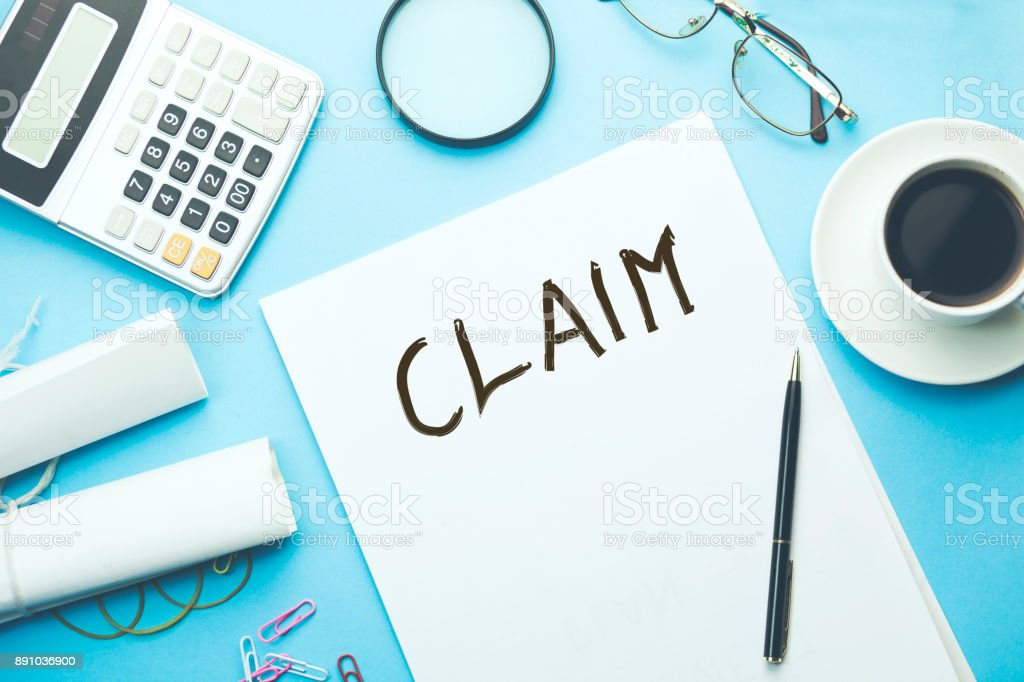 claim text on paper stock photo