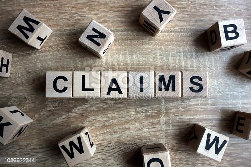 istock Claims word from wooden blocks 1086622344