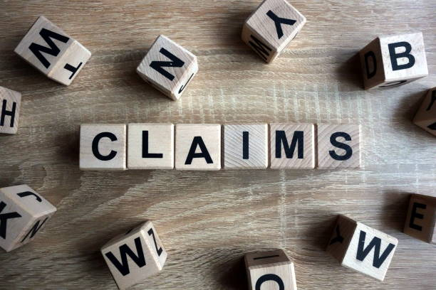 Claims word from wooden blocks stock photo