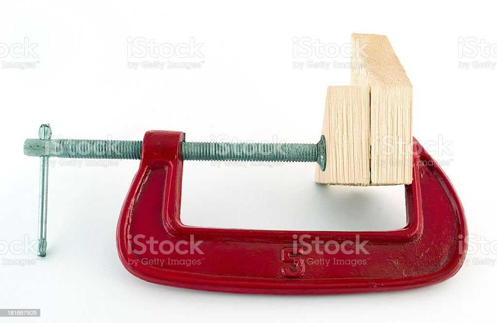 Clamp grips the tree royalty-free stock photo