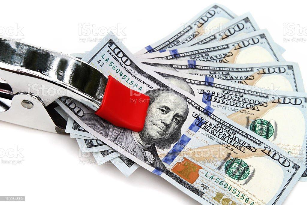 Clamp on hundred dollar bills stock photo