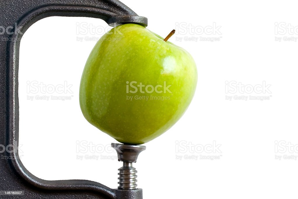 Clamped Apple stock photo