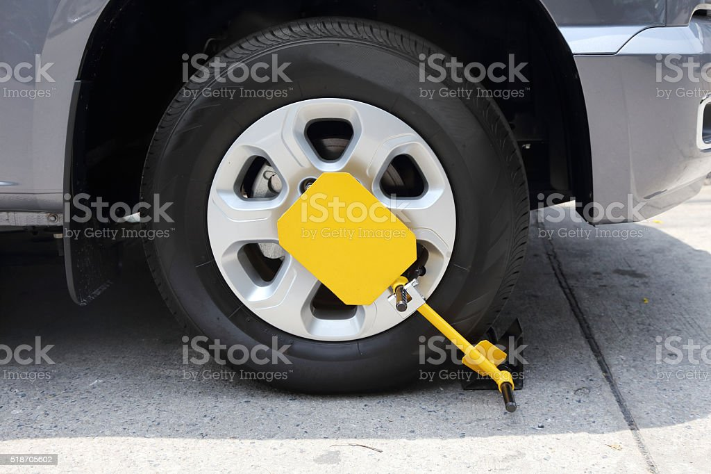 clamped front wheel with yellow wheel lock stock photo