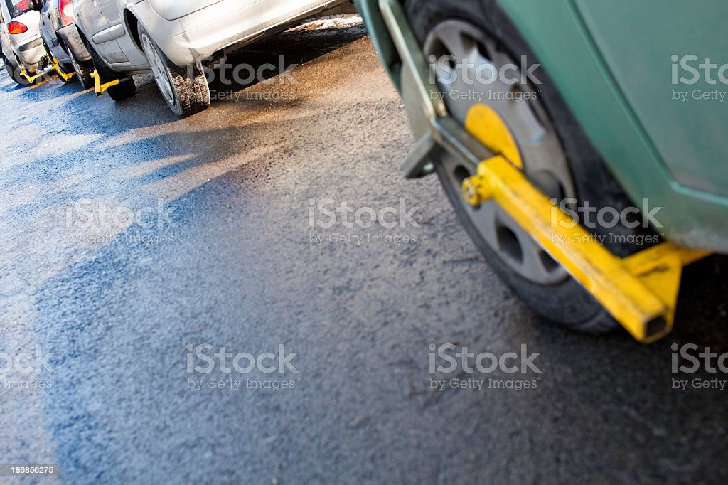 Clamped front wheels in restricted area stock photo