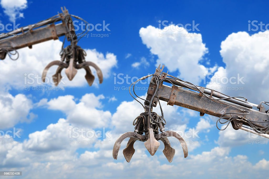 Clamshell and Hydraulic crane with blue sky foto royalty-free