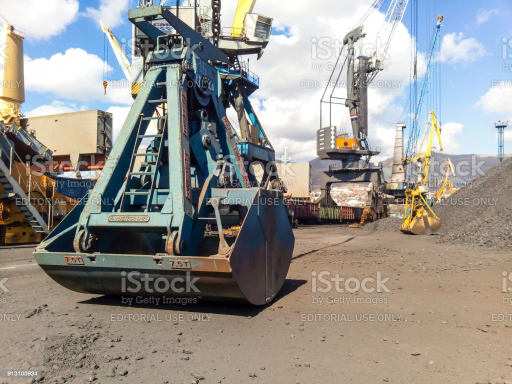 Clamshell bucket in the cargo port. Bucket for loading coal stock photo