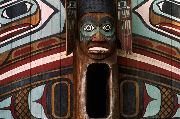 ClanHouse Entrance to Indian clan house a replica of a Tlingit clan house in Totem Bight State Park, Revillagigedo Island, near Ketchikan, Alexander Archipelago, Southeast Alaska, Inside Passage or Alaska's Panhandle. ketchikan stock pictures, royalty-free photos & images