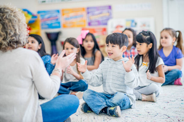 clap your hands - preschool stock photos and pictures