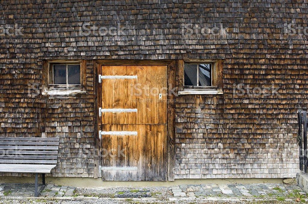 Clapboard house facade with bench stock photo