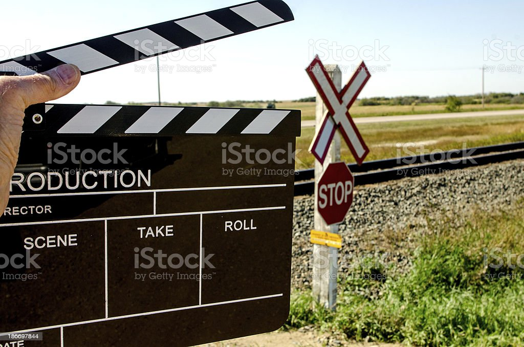 Clapper and Train Tracks royalty-free stock photo