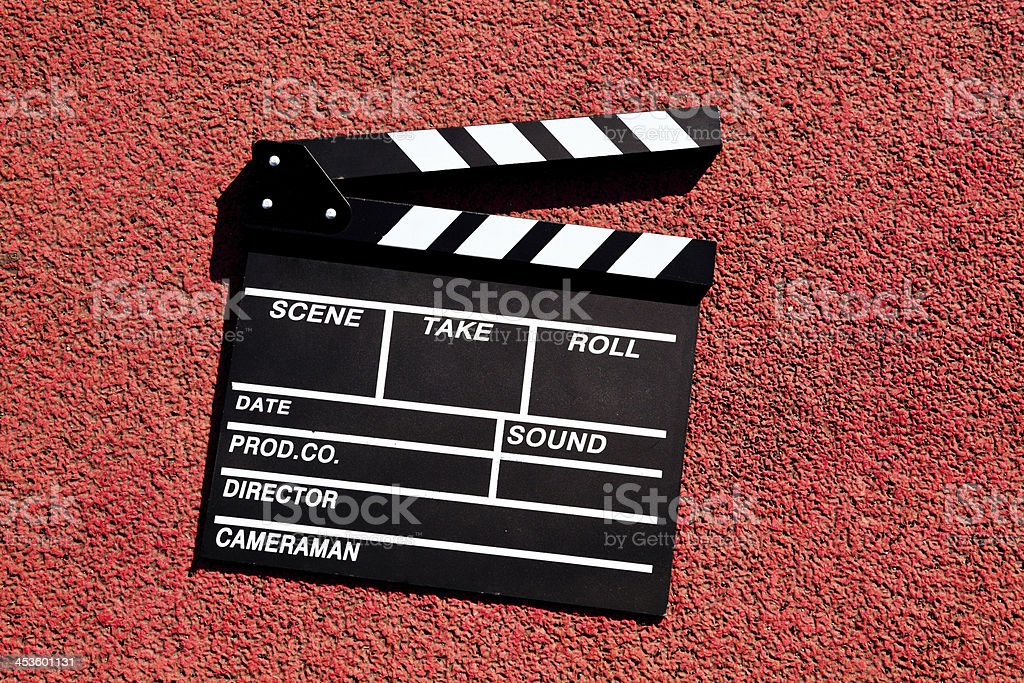 clapper board isolated on red track royalty-free stock photo
