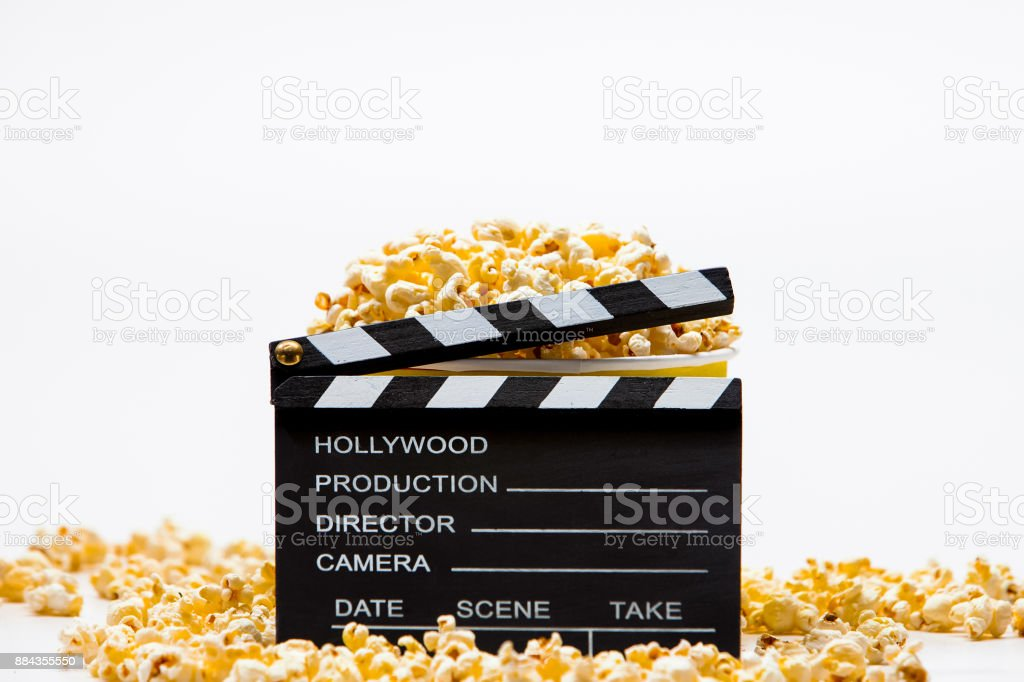Clapper board  with popcorn on copy space isolated stock photo