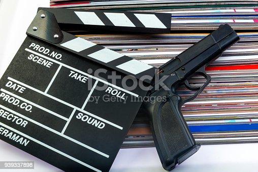 Clapper, gun and magazine.