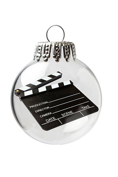 clapperboard in a christmas ornament - weihnachts video stock-fotos und bilder