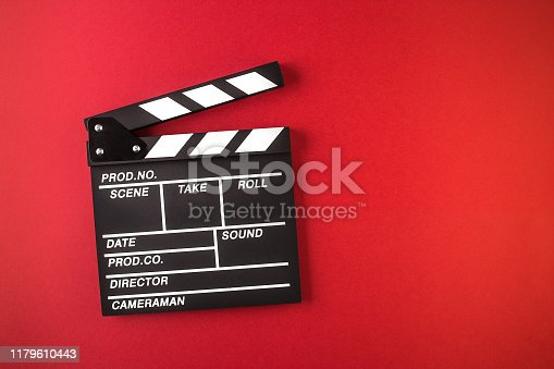 clapperboard, red background