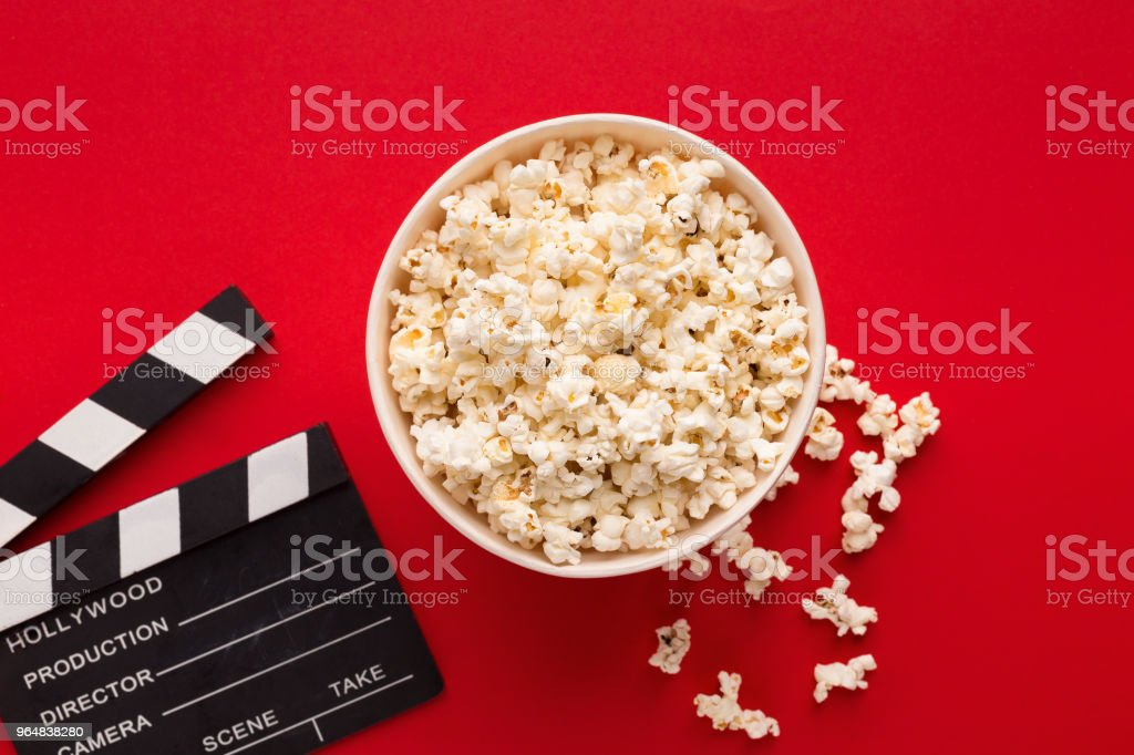 Clapperboard popcorn on red background royalty-free stock photo
