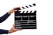 istock Clapperboard sign hold by female hands 857327722