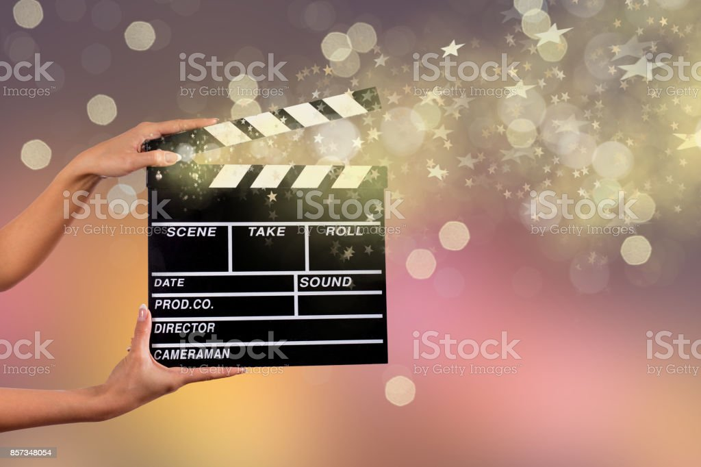 Clapperboard sign hold by female hands stock photo