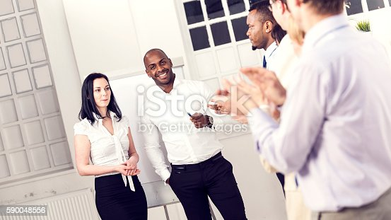 171328775 istock photo Clapping business people 590048556