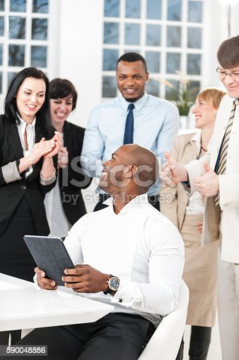 istock Clapping business people 590048886