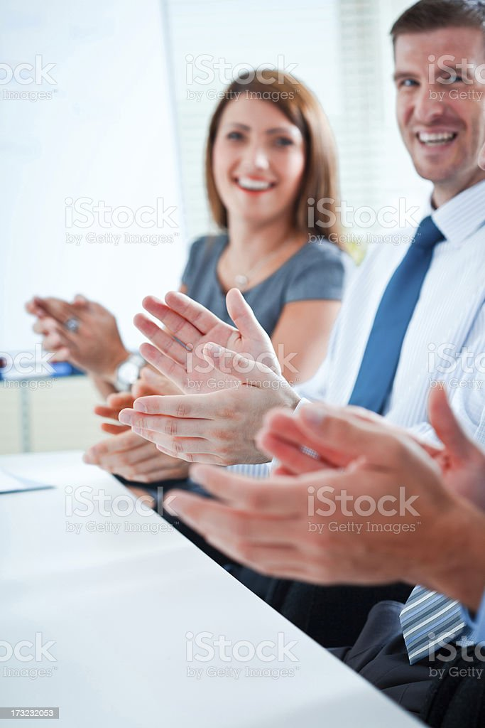 Clapping hands Happy business people clapping hands during business meeting. Admiration Stock Photo