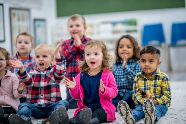 clapping to a song - singing stock photos and pictures