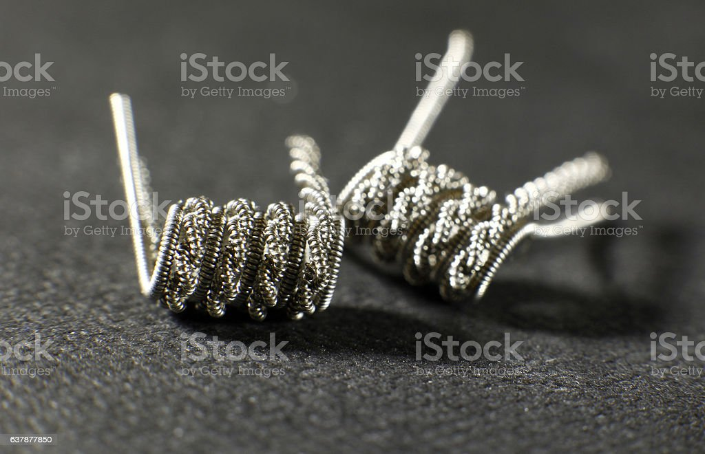 Clapton staged staggered helix coil build for vaping rebuildable atomizer stock photo