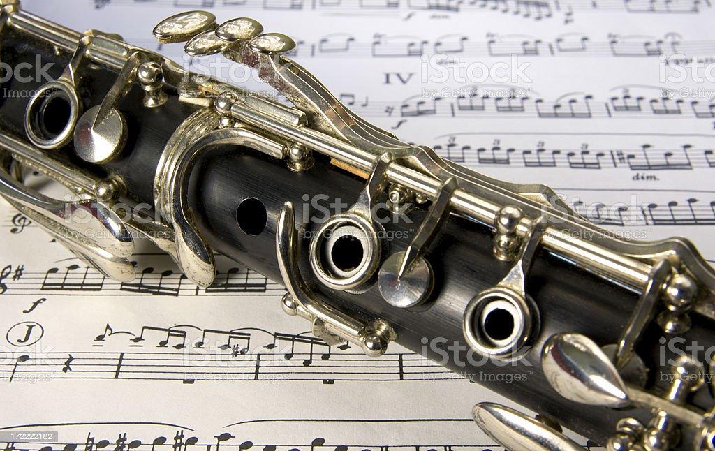 Clarinet keys on music stock photo