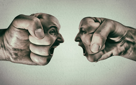 istock Clash of two fists on light background 849254796