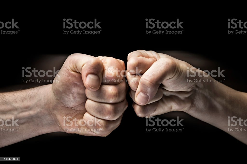 clash of two fists stock photo