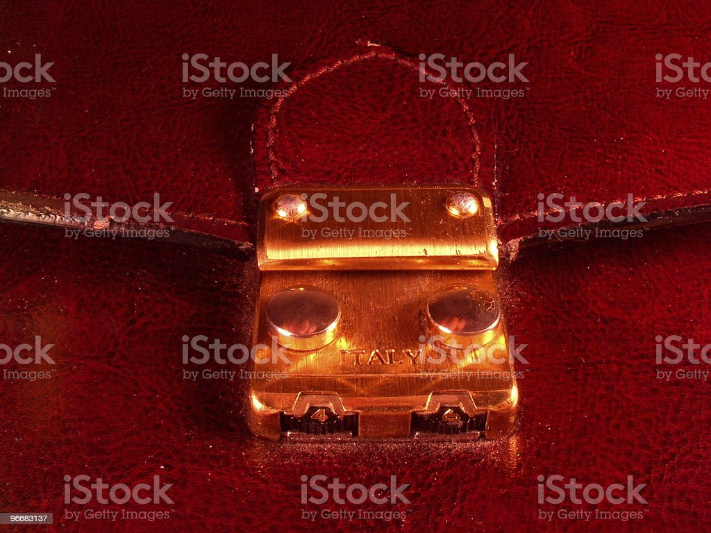 Clasp on an expensive leather briefcase royalty-free stock photo