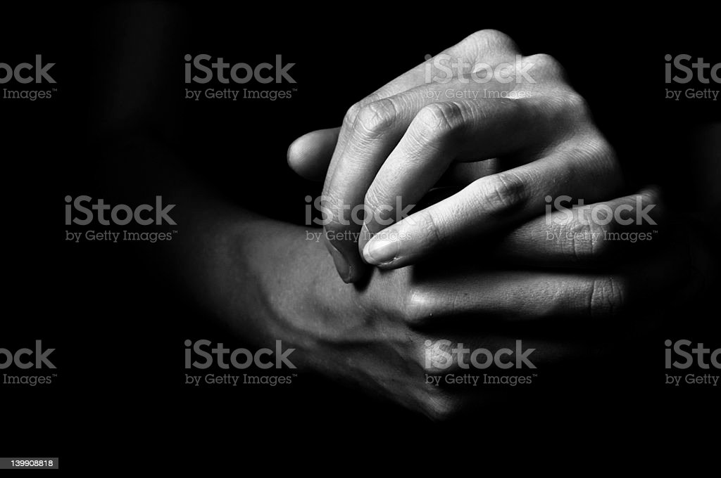 Clasped hands black and white stock photo