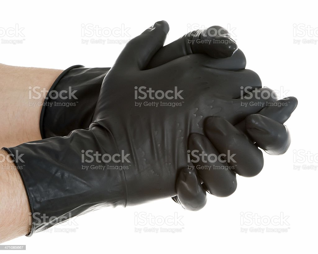 Clasped Hands in Black Rubber Gloves stock photo