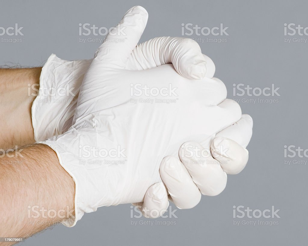 Clasped Hands in Latex Gloves royalty-free stock photo