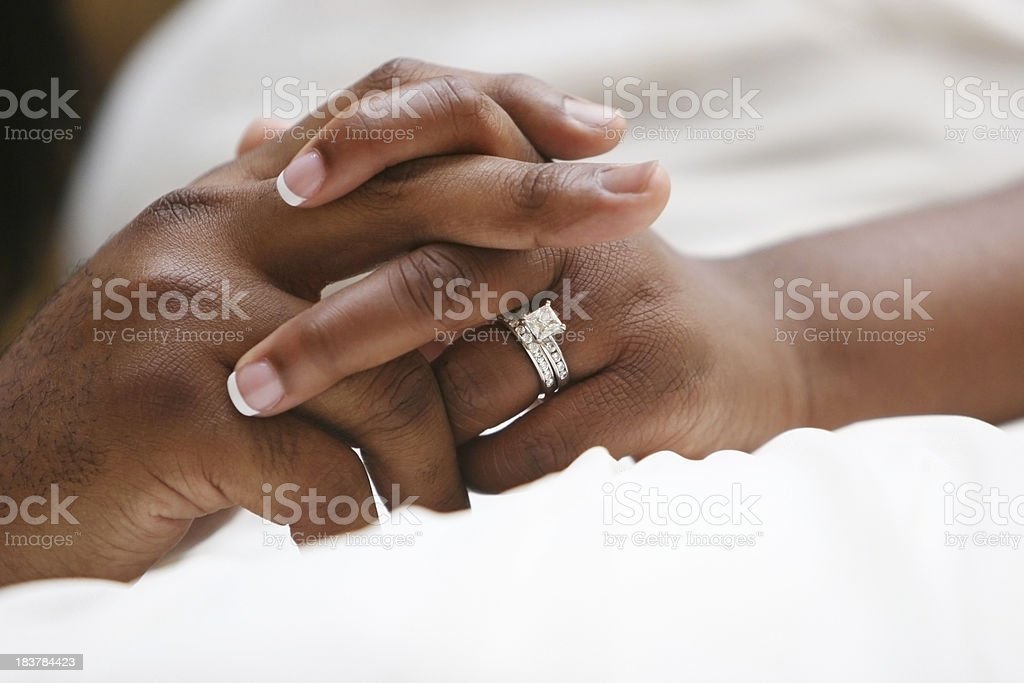 Clasped Hands of Bride and Groom stock photo