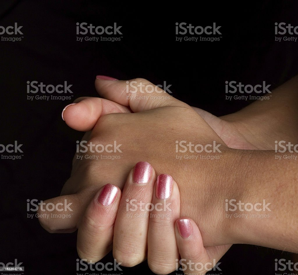 Clasping womans hands royalty-free stock photo
