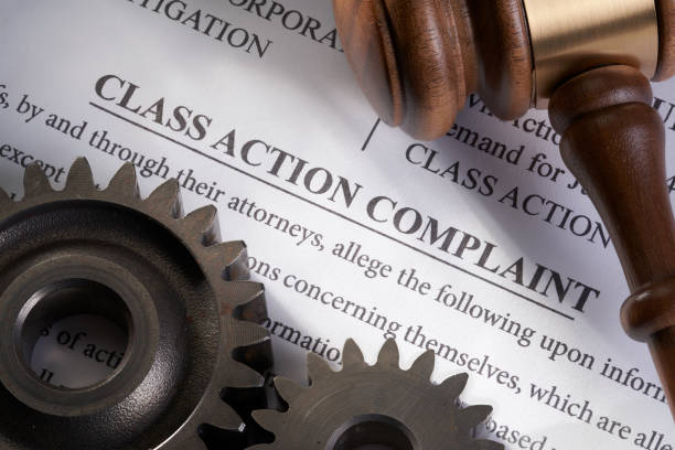 Class Action Lawsuit: Mechanical electrical concept for legal class action lawsuit for mechanical electrical with gears and gavel Class Action Lawsuit: Mechanical electrical concept for legal class action lawsuit for mechanical electrical lawsuit stock pictures, royalty-free photos & images