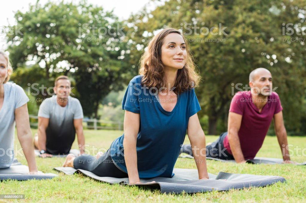 Class doing yoga stock photo