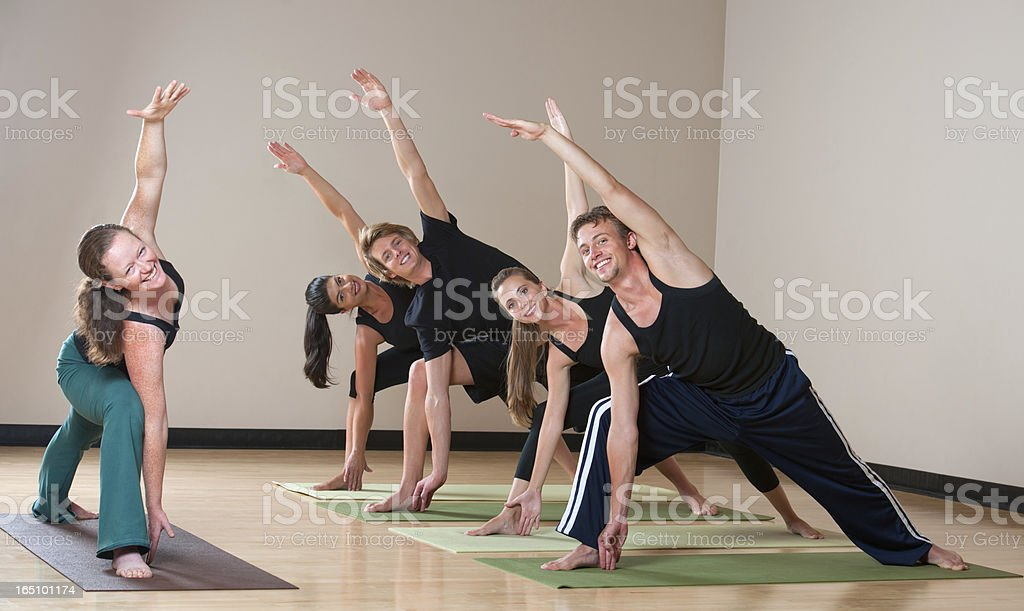 Class in Yoga Studio Smiling and Making Eye Contact stock photo