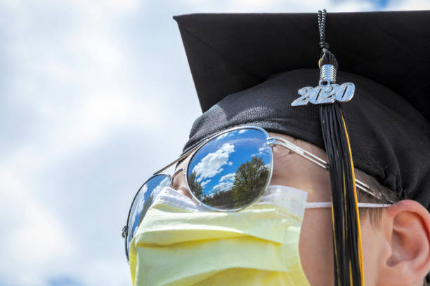 class of 2020 grad in mirror sunglasses - sdominick stock pictures, royalty-free photos & images