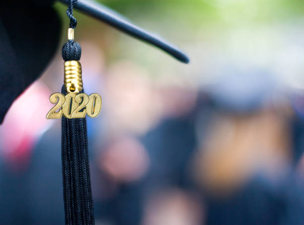 Class of 2020 Graduation Ceremony Tassel Black Closeup of a 2020 Graduation Tassel at a graduation ceremony. modern period stock pictures, royalty-free photos & images