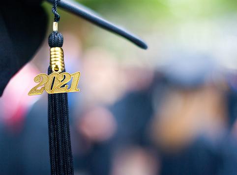 Closeup of a 2021 Graduation Tassel at a graduation ceremony.