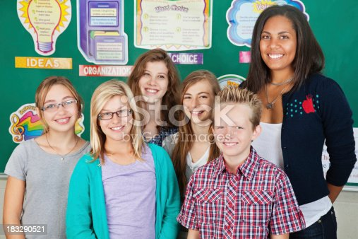 639569206 istock photo Class of Students Standing With Their Teacher 183290521